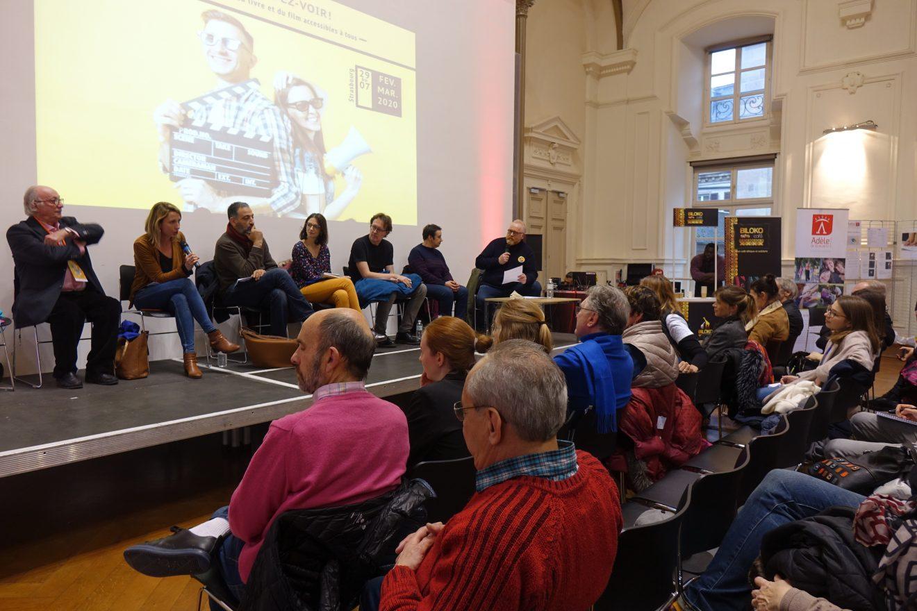 Les intervenants et le public de la conférence